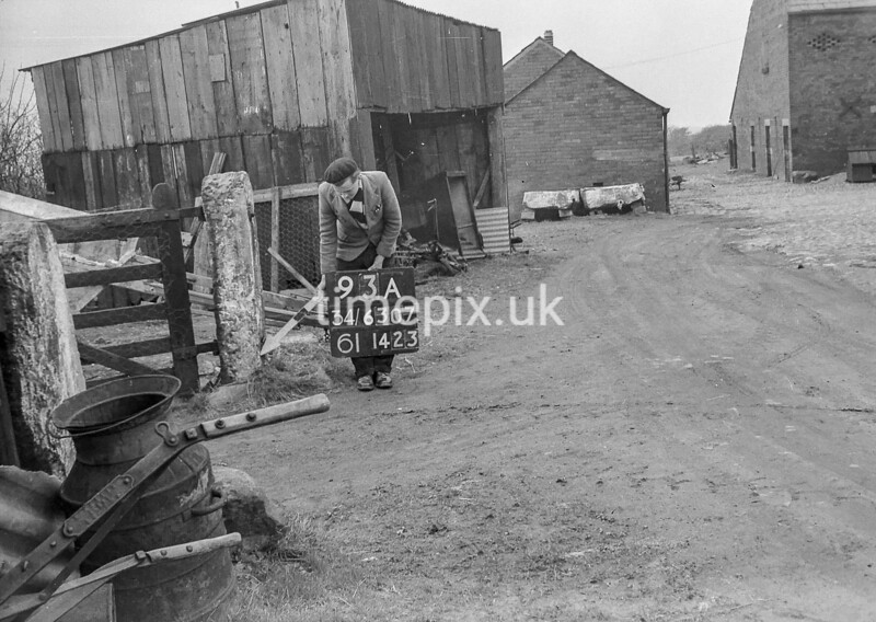 SD630793B, Man marking Ordnance Survey minor control revision point with an arrow in 1950s