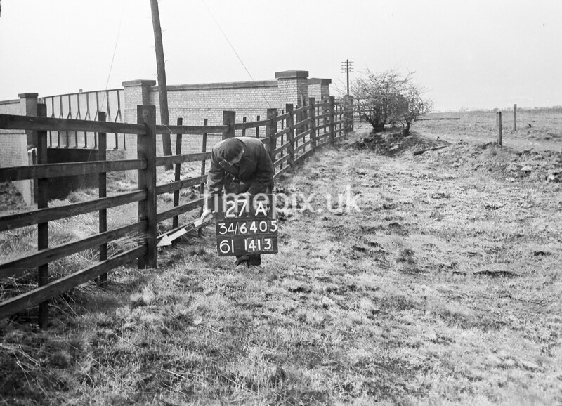 SD640527A, Man marking Ordnance Survey minor control revision point with an arrow in 1950s