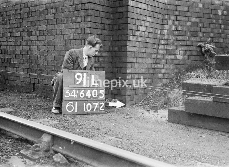 SD640591L, Man marking Ordnance Survey minor control revision point with an arrow in 1940s