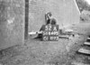 SD640552A, Man marking Ordnance Survey minor control revision point with an arrow in 1940s