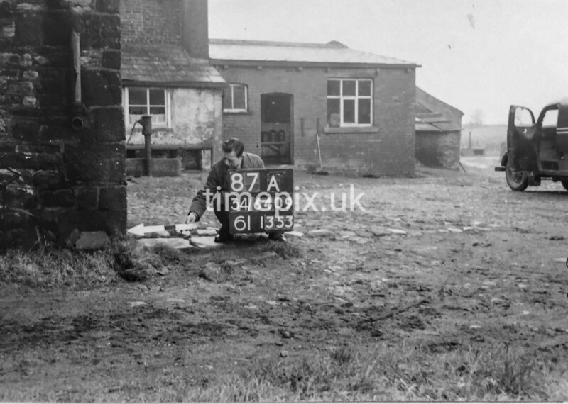 SD640987A, Man marking Ordnance Survey minor control revision point with an arrow in 1940s