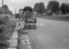 SD640439B, Man marking Ordnance Survey minor control revision point with an arrow in 1940s