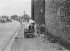 SD620580A, Man marking Ordnance Survey minor control revision point with an arrow in 1940s