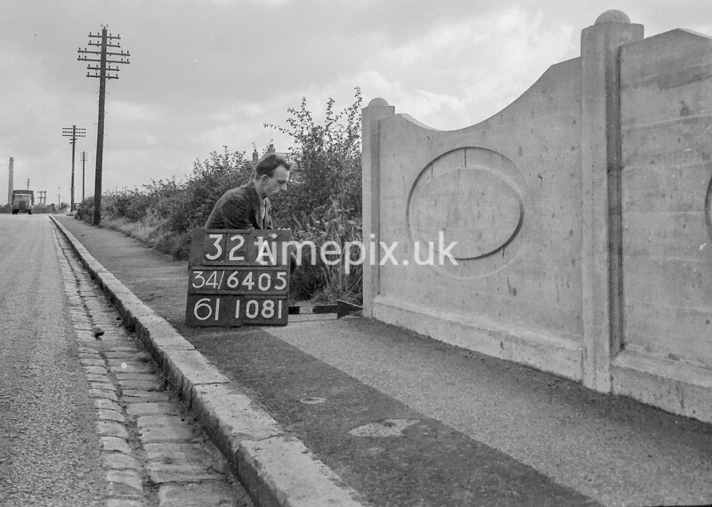 SD640532A, Man marking Ordnance Survey minor control revision point with an arrow in 1940s