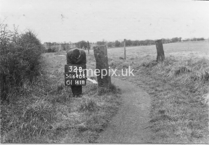 SD640632B, Man marking Ordnance Survey minor control revision point with an arrow in 1950s
