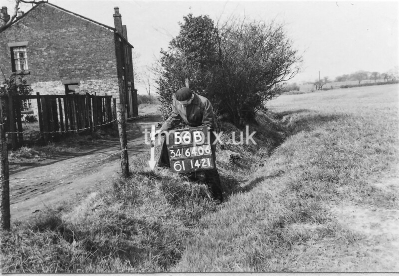 SD640656B, Man marking Ordnance Survey minor control revision point with an arrow in 1950s