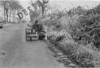 SD640894A, Man marking Ordnance Survey minor control revision point with an arrow in 1940s