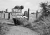 SD640598A, Man marking Ordnance Survey minor control revision point with an arrow in 1940s