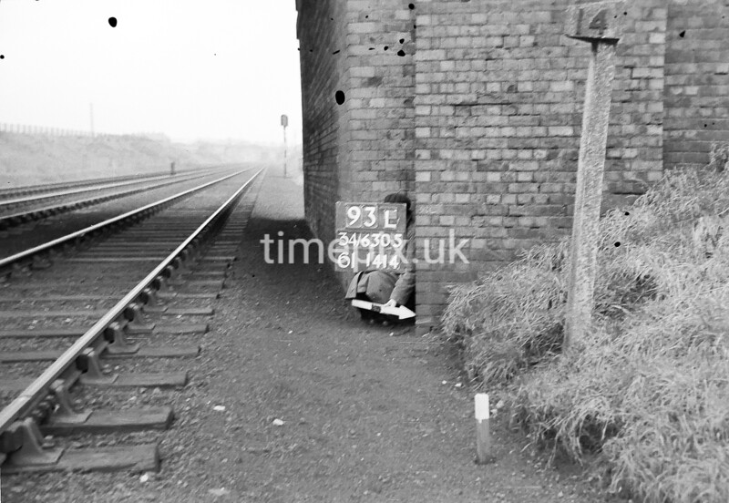 SD630593L, Man marking Ordnance Survey minor control revision point with an arrow in 1940s