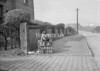 SD630552A, Man marking Ordnance Survey minor control revision point with an arrow in 1940s