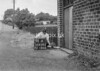SD620591A, Man marking Ordnance Survey minor control revision point with an arrow in 1940s