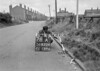 SD620478A, Man marking Ordnance Survey minor control revision point with an arrow in 1940s