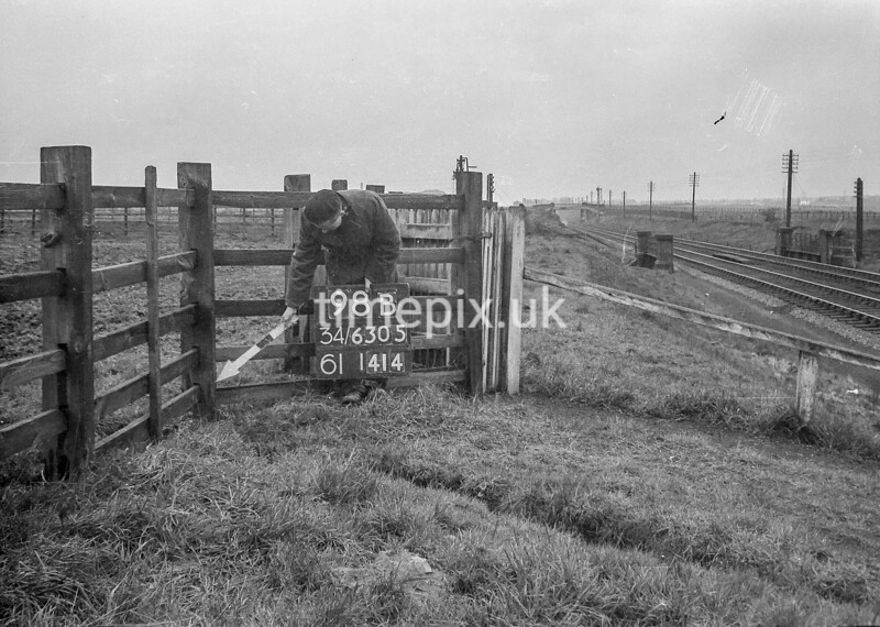 SD630598B, Man marking Ordnance Survey minor control revision point with an arrow in 1940s