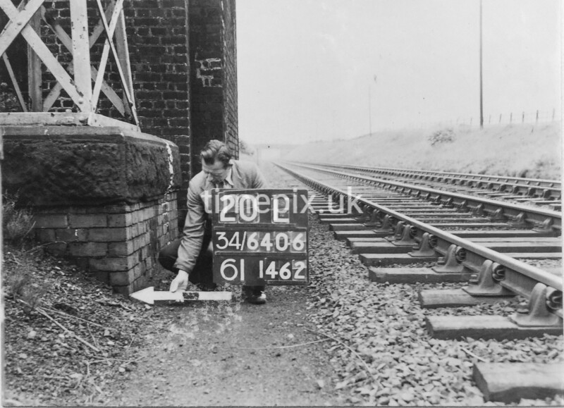 SD640620L, Man marking Ordnance Survey minor control revision point with an arrow in 1950s