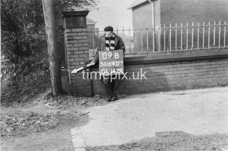 SD640709B, Man marking Ordnance Survey minor control revision point with an arrow in 1950s