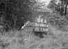 SD640484A, Man marking Ordnance Survey minor control revision point with an arrow in 1940s