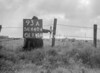 SD640493A, Man marking Ordnance Survey minor control revision point with an arrow in 1940s
