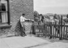 SD620489A, Man marking Ordnance Survey minor control revision point with an arrow in 1940s