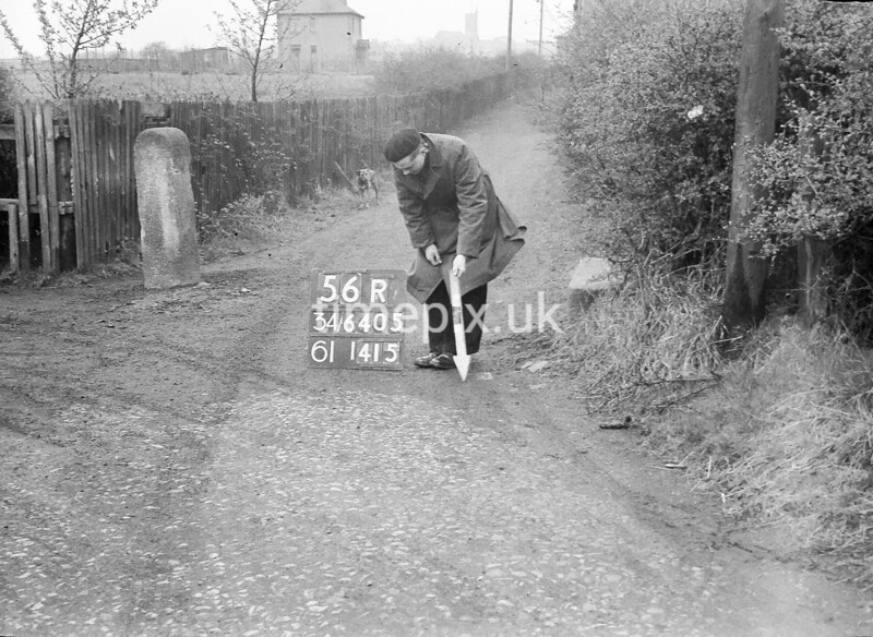 SD640556R, Man marking Ordnance Survey minor control revision point with an arrow in 1950s
