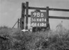 SD640498B, Man marking Ordnance Survey minor control revision point with an arrow in 1940s