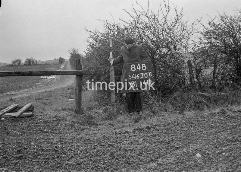 SD630684B, Man marking Ordnance Survey minor control revision point with an arrow in 1950s