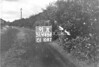 SD640691A, Man marking Ordnance Survey minor control revision point with an arrow in 1940s