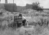 SD620450B, Man marking Ordnance Survey minor control revision point with an arrow in 1940s