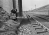 SD640517L, Man marking Ordnance Survey minor control revision point with an arrow in 1950s