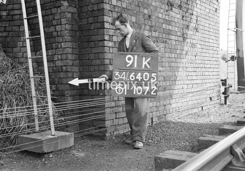 SD640591K, Man marking Ordnance Survey minor control revision point with an arrow in 1940s