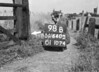 SD640598B, Man marking Ordnance Survey minor control revision point with an arrow in 1940s