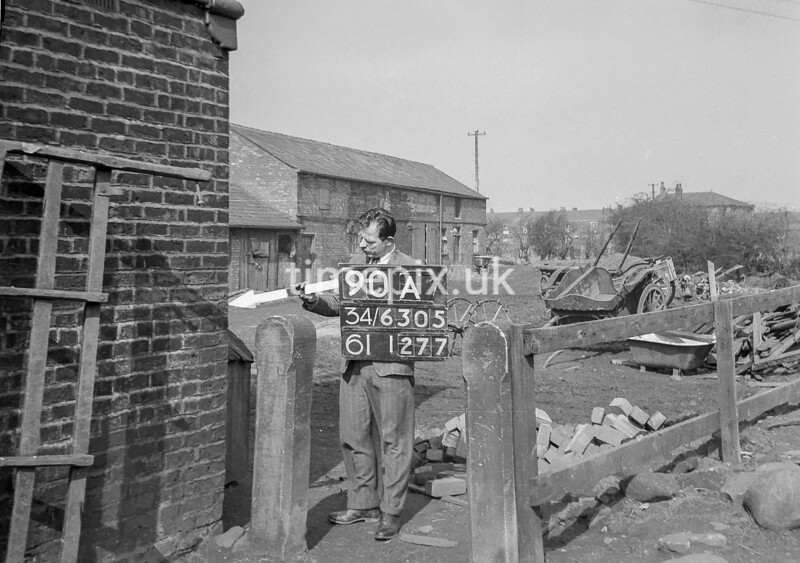 SD630590A, Man marking Ordnance Survey minor control revision point with an arrow in 1940s