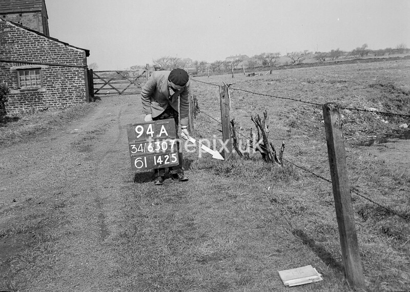 SD630794A, Man marking Ordnance Survey minor control revision point with an arrow in 1950s