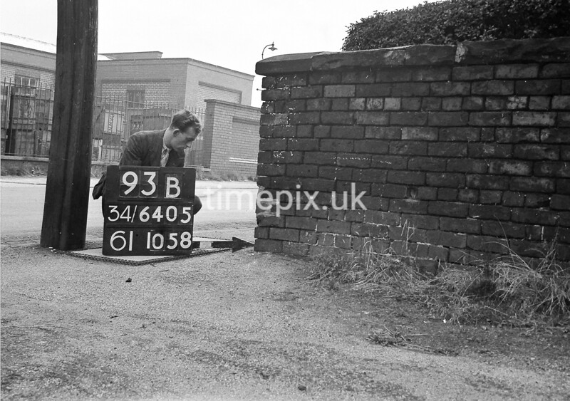 SD640593B, Man marking Ordnance Survey minor control revision point with an arrow in 1940s
