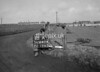 SD640418A, Man marking Ordnance Survey minor control revision point with an arrow in 1940s