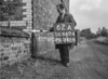 SD640462A, Man marking Ordnance Survey minor control revision point with an arrow in 1940s