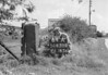 SD630864A, Man marking Ordnance Survey minor control revision point with an arrow in 1950s