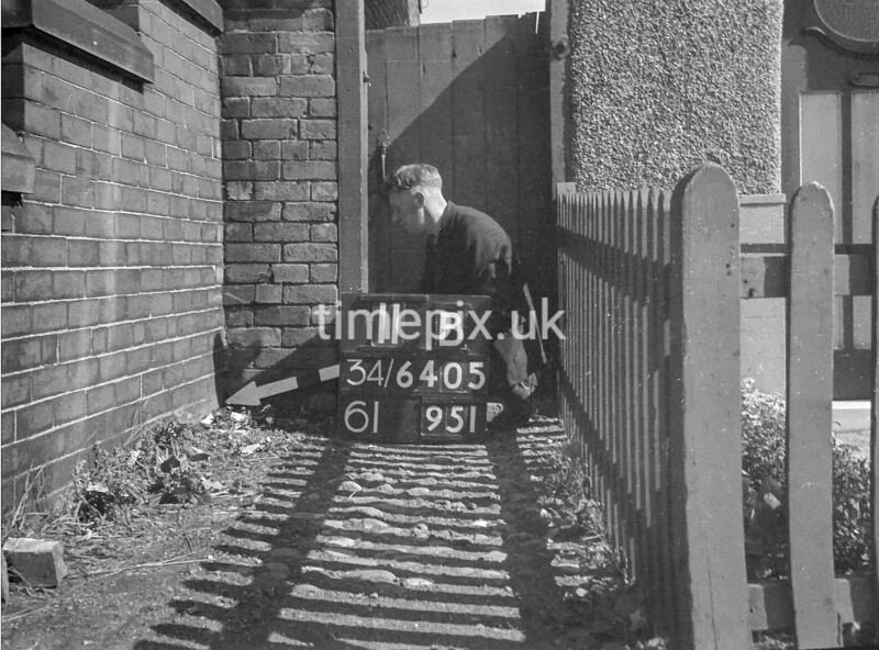 SD640511B, Man marking Ordnance Survey minor control revision point with an arrow in 1940s