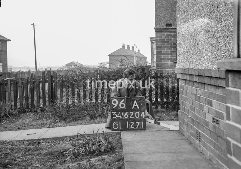 SD620496A, Man marking Ordnance Survey minor control revision point with an arrow in 1940s