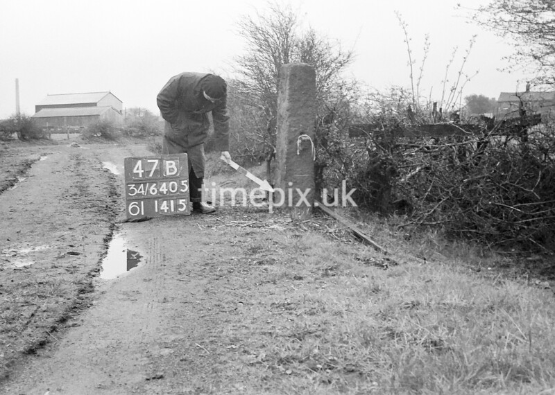 SD640547B, Man marking Ordnance Survey minor control revision point with an arrow in 1950s