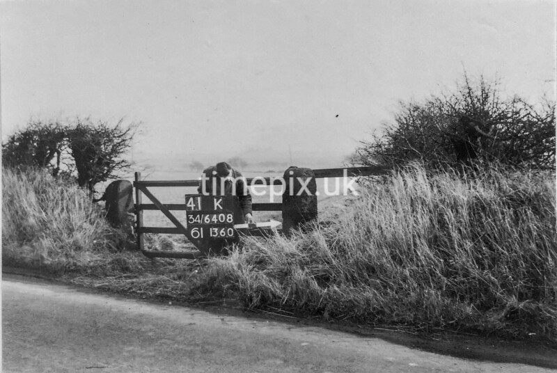 SD640841K, Man marking Ordnance Survey minor control revision point with an arrow in 1940s