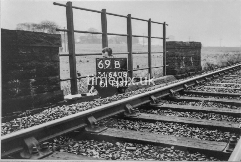 SD640869B, Man marking Ordnance Survey minor control revision point with an arrow in 1940s