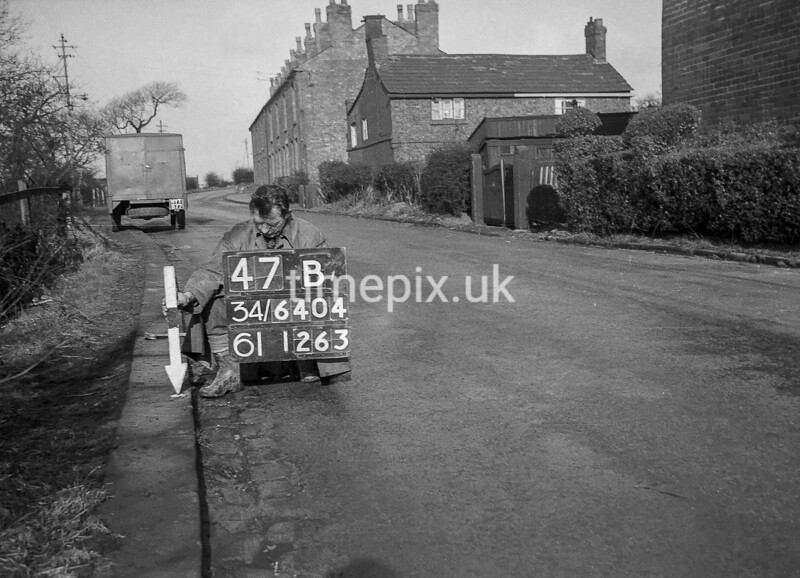 SD640447B, Man marking Ordnance Survey minor control revision point with an arrow in 1940s