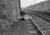 SD630671L, Man marking Ordnance Survey minor control revision point with an arrow in 1950s