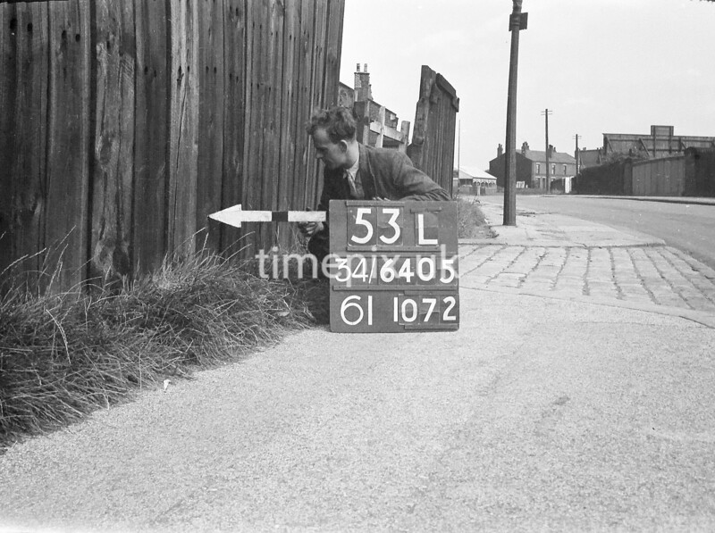SD640553L, Man marking Ordnance Survey minor control revision point with an arrow in 1940s