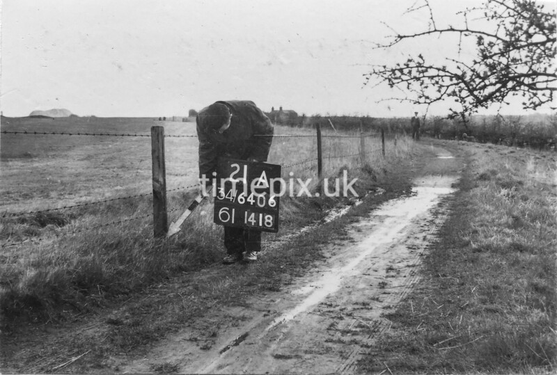 SD640621A, Man marking Ordnance Survey minor control revision point with an arrow in 1950s