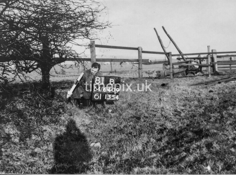 SD640981B, Man marking Ordnance Survey minor control revision point with an arrow in 1940s