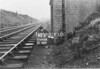 SD640662A, Man marking Ordnance Survey minor control revision point with an arrow in 1950s