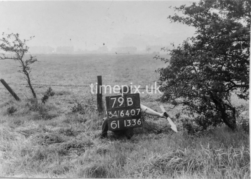SD640779B, Man marking Ordnance Survey minor control revision point with an arrow in 1940s