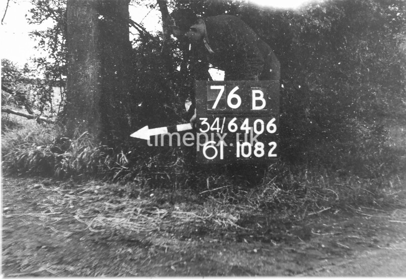 SD640676B, Man marking Ordnance Survey minor control revision point with an arrow in 1940s