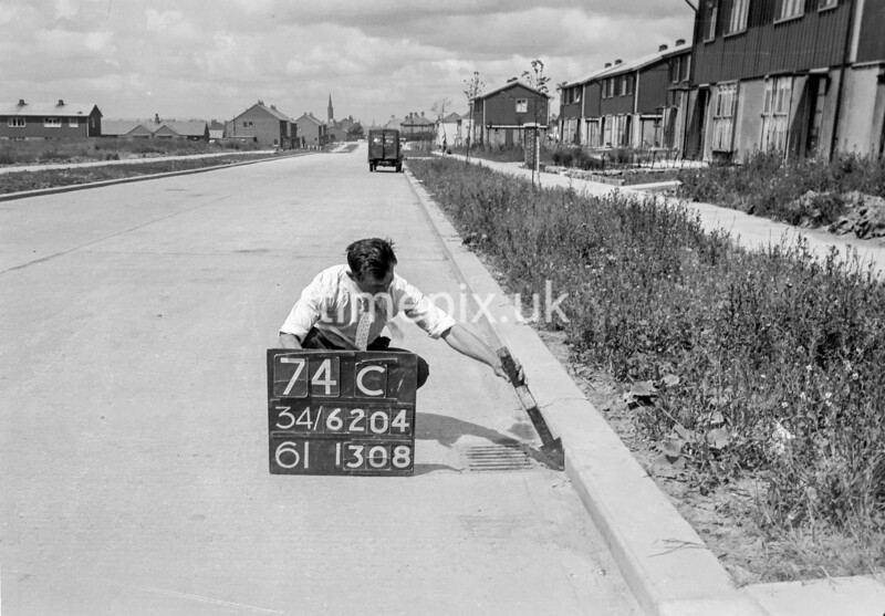 SD620474C, Man marking Ordnance Survey minor control revision point with an arrow in 1940s
